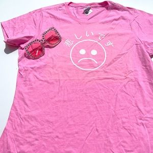 Pink Tee with sad face graphic print